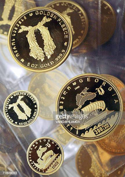 Picture taken 11 September 2006 shows gold coins of different denominations produced by the Georgian national bank in Tbilisi 11 September 2006 The...
