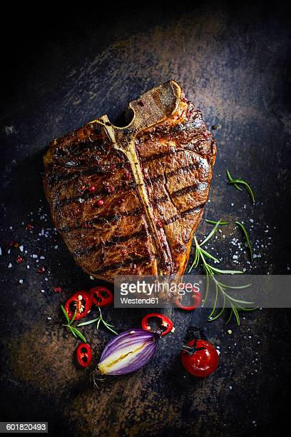 T-Bone-Steak, chili, onion, cherry tomato and rosemary