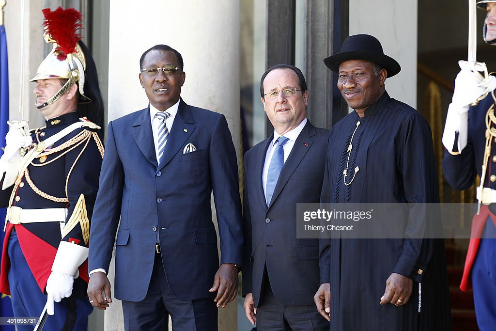 Tchad's President Idriss Deby (L), French President Francois Hollande (C) and Nigeria's President Goodluck Jonathan (R) pose for a picture before an African security summit on May 17, 2014, at the Elysee palace in Paris, France. The African security summit is being held to discuss the Boko Haram threat to regional stability.