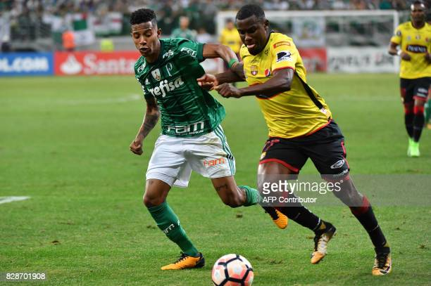 Tche Tche of Brazil's Palmeiras vies for the ball with Erick Arroyo of Ecuador's Barcelona during their 2017 Copa Libertadores football match held at...