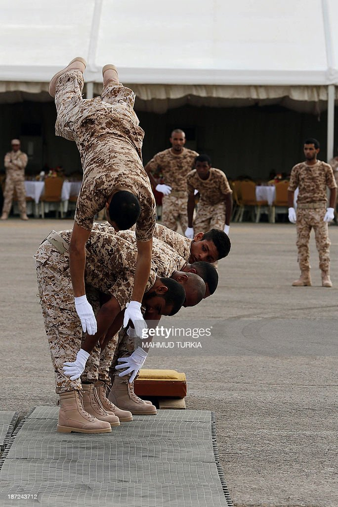 Te first batch of newly graduated Libyan border guards show their skills during a graduation ceremony on November 7, 2013 in Tripoli.