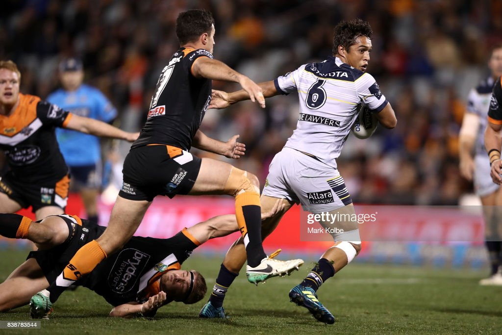 Te Maire Martin of the Cowboys is tackled during the round 25 NRL match between the Wests Tigers and the North Queensland Cowboys at Campbelltown Sports Stadium on August 25, 2017 in Sydney, Australia.
