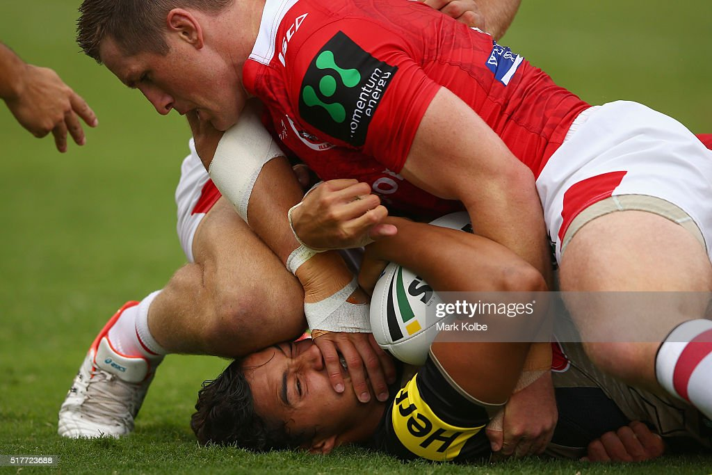 Te Maire Martin of the Panthers is tackled by Josh McCrone of the Dragons during the round four NRL match between the St George Illawarra Dragons and...