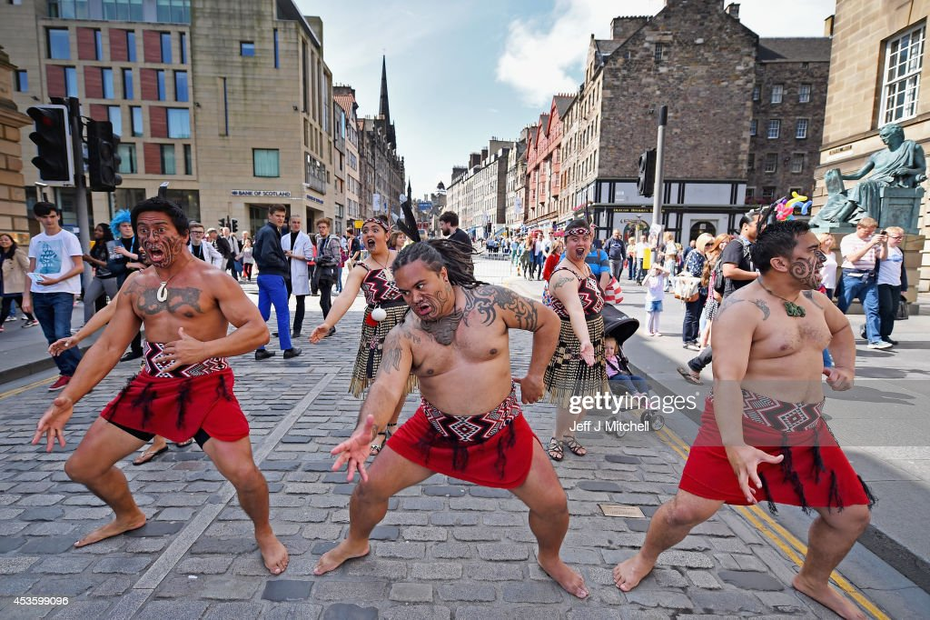 Te Matatini Kapa Haka Aotearoa perform the Haka at the Edinburgh Festival Fringe on the Royal Mile on August 14, 2014 in Edinburgh, Scotland. The largest performing arts festival in the world, this years festival hosts more than 3,000 shows in nearly 300 venues across the city.
