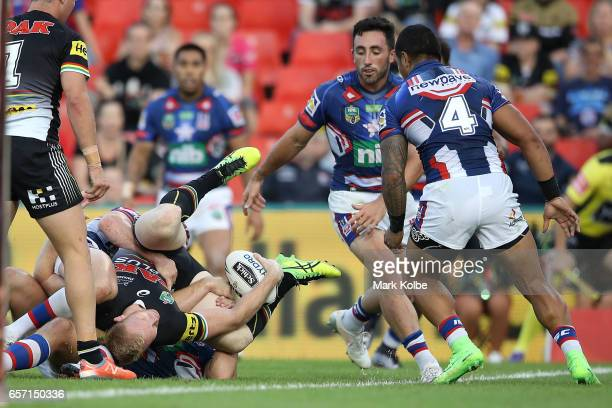 Te Peter Wallace of the Panthers is tackled short of the try line during the round four NRL match between the Penrith Panthers and the Newcastle...