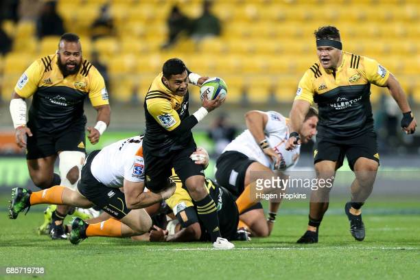 Te Toiroa Tahuriorangi of the Hurricanes is tackled during the round 13 Super Rugby match between the Hurricanes and the Cheetahs at Westpac Stadium...
