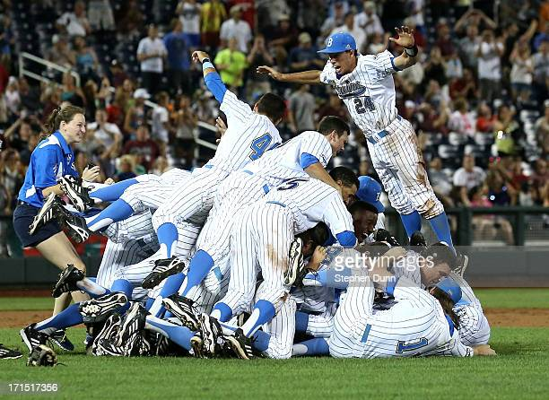 Te UCLA Bruins jump into a pile to celebrate after getting the final out against the Mississippi State Bulldogs during game two of the College World...