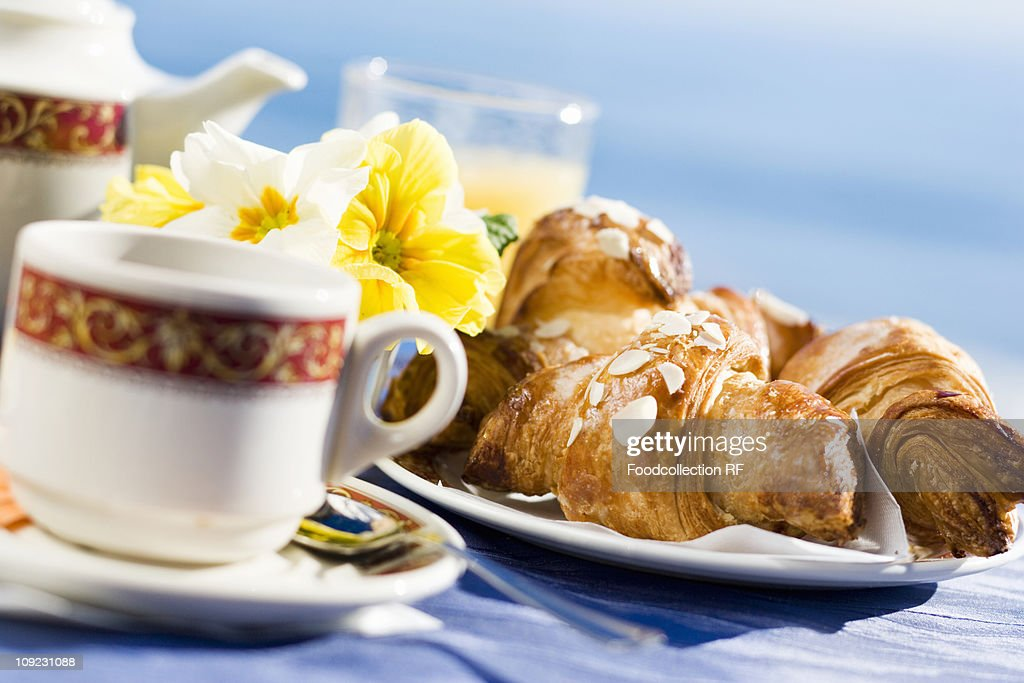 Tea and almond croissants for breakfast, close-up : Stock Photo