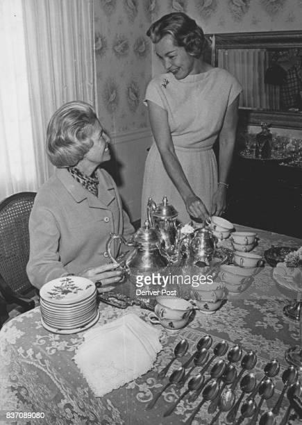 Tea and Cakes for Patron Committee Mrs Henry Van Schaack Jr left Deb Ball cochairman pours tea for Mrs Robert Hawley ball patron chairman Credit...