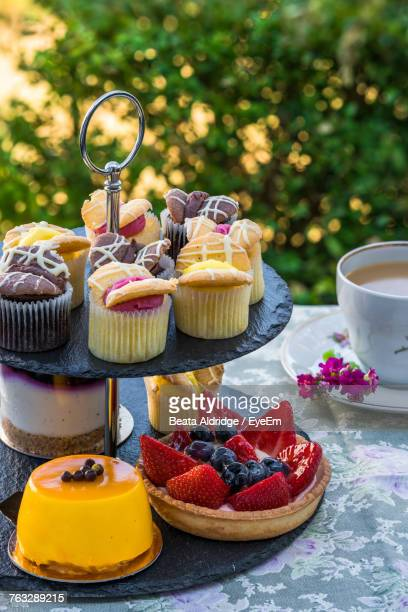 Tea And Dessert On Cakestand At Table Outdoors