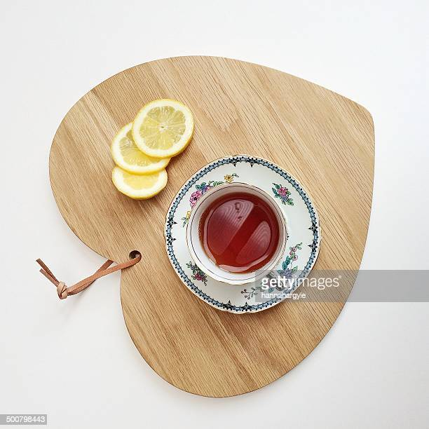 Tea and lemon slices on a chopping board