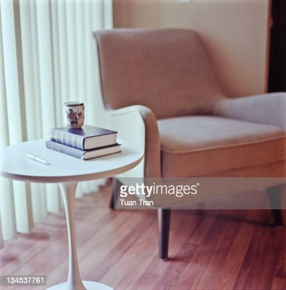 Tea cup, pen and books on table : Stock Photo