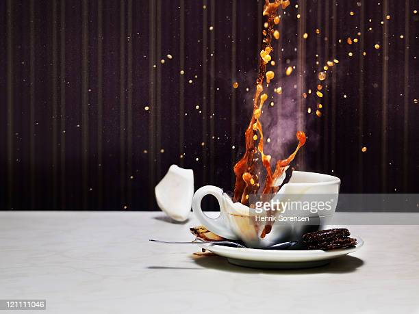 Tea cup shattering on table
