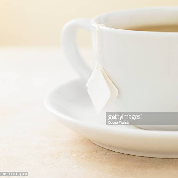 Tea cup with tea bag in, close up