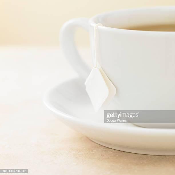 Tea cup with tea bag in, close up