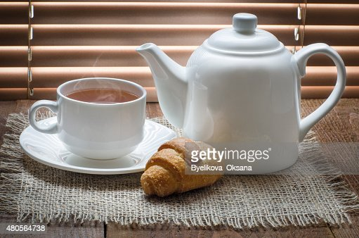 tea cup with teapot on old wooden table : Stock Photo