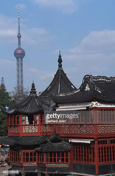 A tea house in Yuyuan Garden in Shanghai with the Oriental TV Tower in Pudong in the background