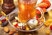 turk tea with nuts and oriental sweets.Tea still life