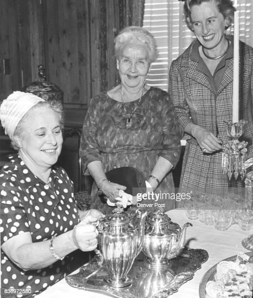 Tea is First Event at New Margaret Phipps Center Mrs Chester Alter pours for Mrs Rollie Bradford Center and Mrs James Stokes at University of Denver...