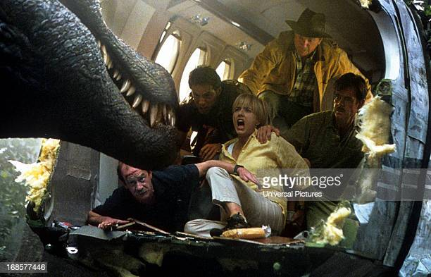 Tea Leoni William H Macy and others scream at the sight of a dinosaur in a scene from the film 'Jurassic Park III' 2001