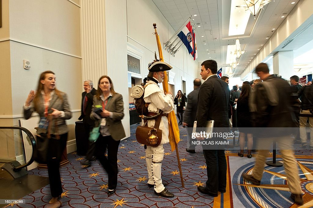 A Tea Party activist dressed in Revolution-era garb speaks with an attendee at the Conservative Political Action Conference (CPAC) in National Harbor, Maryland, on March 15, 2013. AFP PHOTO/Nicholas KAMM