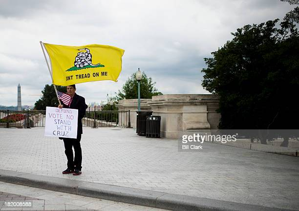 Tea Party activist Ronald Kirby of Alexandria Va holds a one man vigil outside of the Capitol near the Senate steps on Friday Sept 27 to encourage...