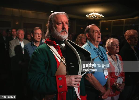 Tea Party activist William Temple and others stand during the Pledge of Allegiance at the 2014 Values Voter Summit September 26 2014 in Washington DC...