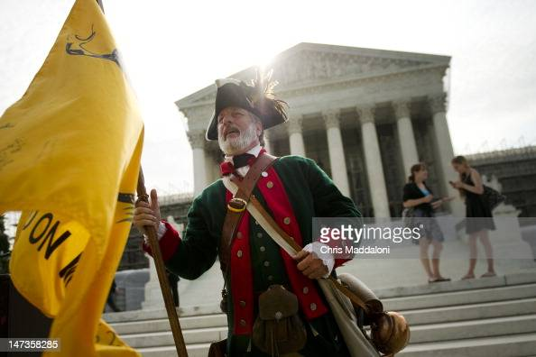 Tea Party activist William Temple protests against the Affordable Care Act before the Supreme announces its decision about the constitutionality of...