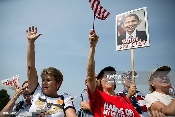 Tea Party activists cheer during the 'Exempt America from Obamacare' rally on Capitol Hill September 10 2013 in Washington DC Some conservative...
