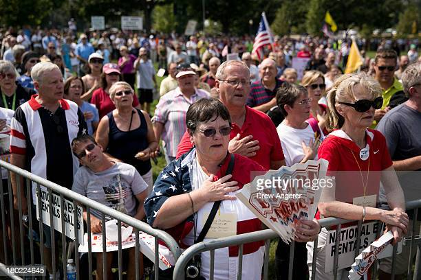 Tea Party activists recite the Pledge of Allegiance at the beginning of the 'Exempt America from Obamacare' rally on Capitol Hill September 10 2013...