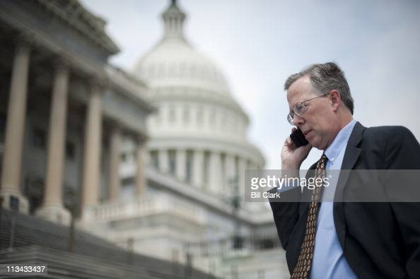 Tea Party lobbyist Andrew Cochran talks on his cell phone at the US Capitol on Monday May 2 2011