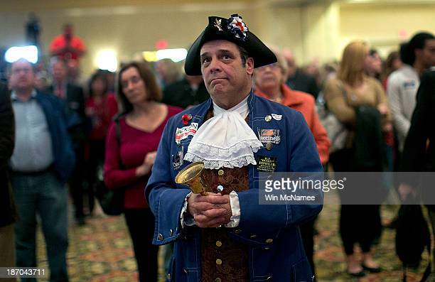 Tea Party member John Wallmeyer watches results from the Virginia Governor's race at an election night gathering of supporters of Republican...