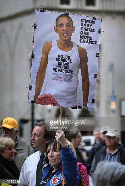 Tea Party members rally to protest President Barack Obama's proposed 'Buffett rule' tax plan on April 16 2012 in Chicago Illinois The tax plan which...