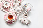 Tea party with a lot of antique crockery