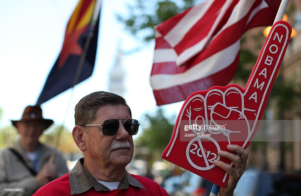 A Tea Party protester holds a sign during a demonstration outside of a fundraiser for U.S. President Barack Obama on June 6, 2012 in San Francisco, California. Hundreds of spectators and protesters gathered outside of two fundraisers for Barack Obama during a four hour trip to San Francisco where he earned $2 million for his campaign.