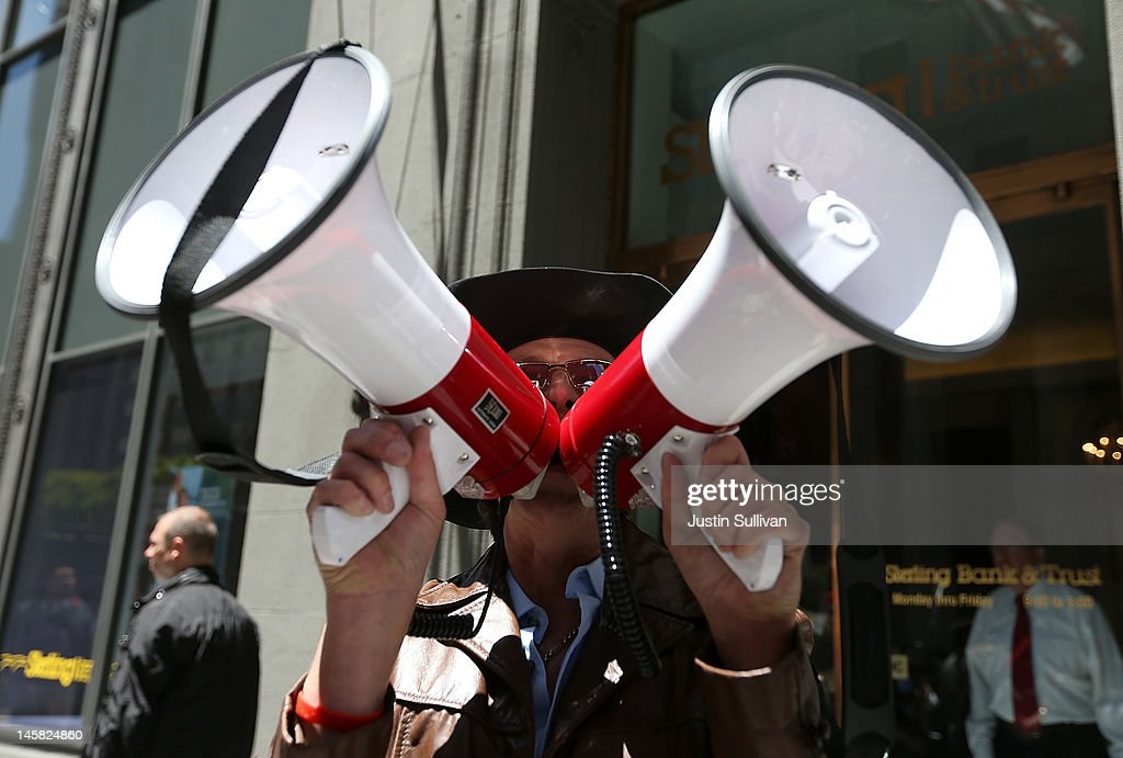 A Tea Party protester uses two megaphones during a demonstration outside of a fundraiser for U.S. President Barack Obama on June 6, 2012 in San Francisco, California. Hundreds of spectators and protesters gathered outside of two fundraisers for Barack Obama during a four hour trip to San Francisco where he earned $2 million for his campaign.