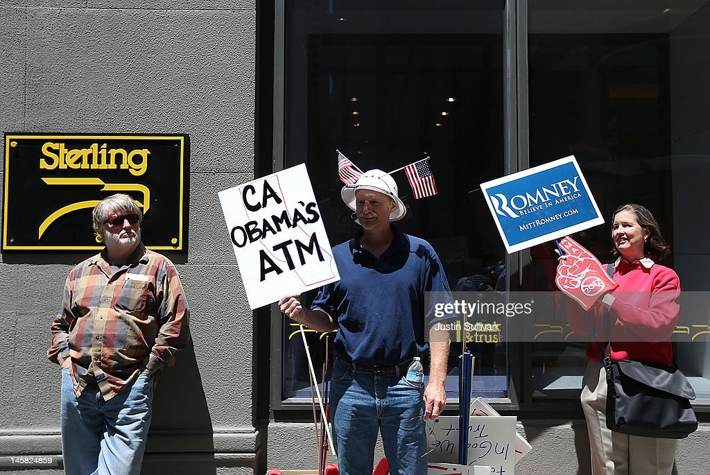 Tea Party protesters hold signs during a demonstration outside of a fundraiser for U.S. President Barack Obama on June 6, 2012 in San Francisco, California. Hundreds of spectators and protesters gathered outside of two fundraisers for Barack Obama during a four hour trip to San Francisco where he earned $2 million for his campaign.