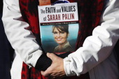 Tea Party supporter holds a Sarah Palin book during a Tea Party Express rally on Waterbury Green November 1 2010 in Waterbury Connecticut Midterm...