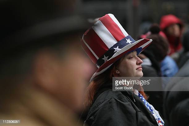 Tea Party supporter listens to speakers at a Tax Day rally at the Daley Center Plaza April 18 2011 in Chicago Illinois Several hundred people...