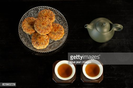 A tea set and plate of moon cakes, associated with Chinese tea culture and the Autumn Harvest Moon festival. : Stock Photo