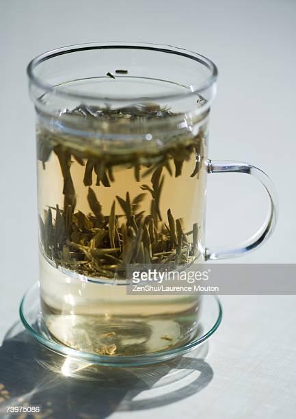 Tea steeping in mug with tea strainer