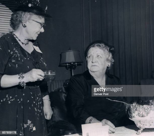 Tea table chatters at the Denver Orphans Home party Tuesday were Mrs Louis P Bansbach and Mrs Gerald Hughes both members of the board The home is...