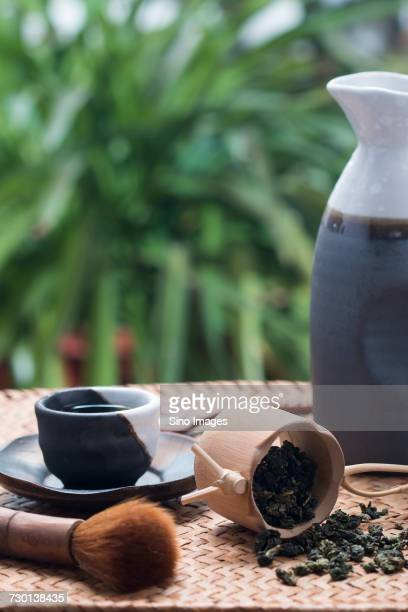 Tea whisk, mug with dried green tea leaves, jug and tea cup, China