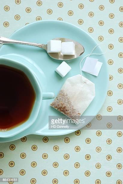 Tea with sugar cubes