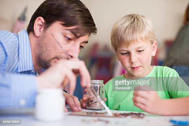 Teacher and boy in art class