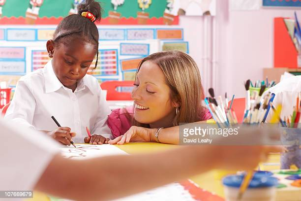 Teacher and child in classroom