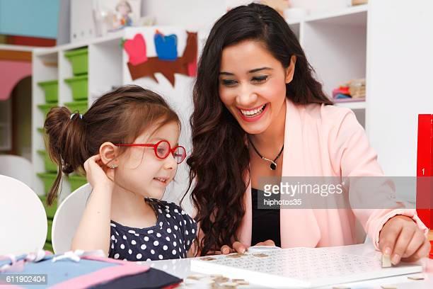Teacher and Kid Lesson  Clock at Kindergarten