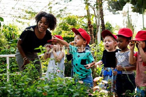Teacher and kids school learning ecology gardening : Stock Photo