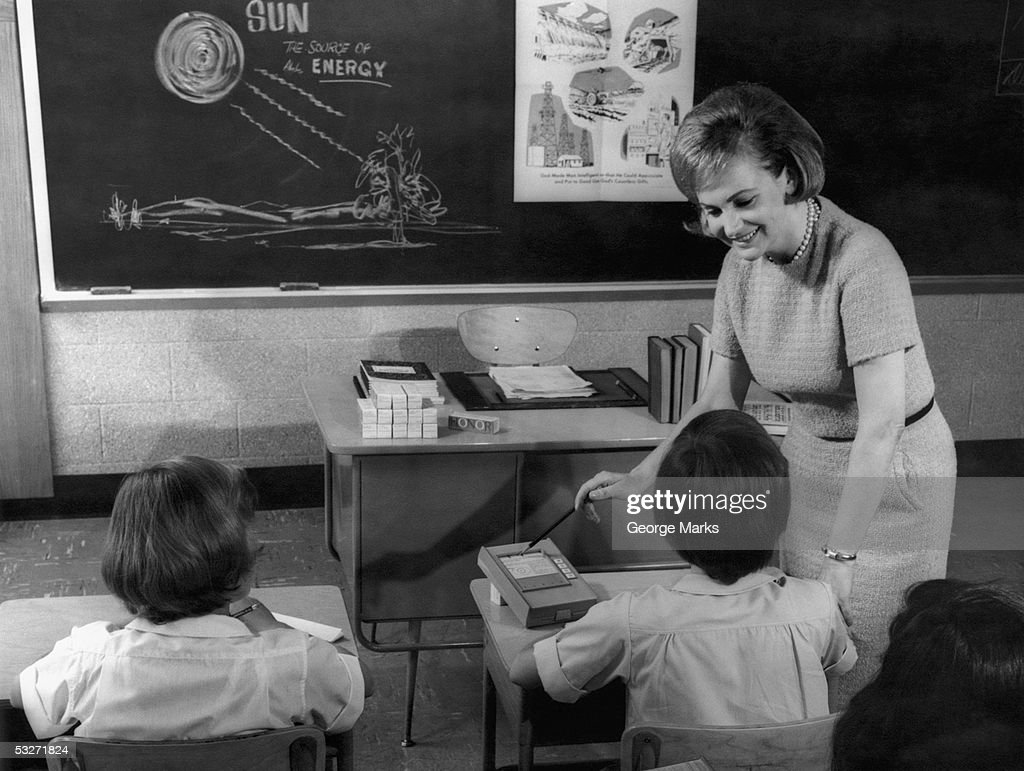 Teacher and primary school students in classroom : Stock Photo