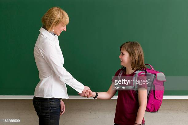 teacher and pupil shaking hands